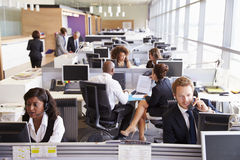 Colleagues busy working at desks in an open plan office Stock Photo