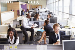 Colleagues busy working at desks in an open plan office Stock Images