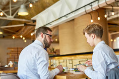 Colleagues in cafe Royalty Free Stock Photography