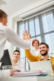 Colleagues celebrate success with High Five royalty free stock image