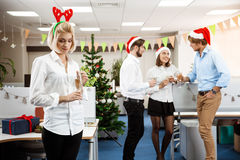 Colleagues celebrating christmas party in office drinking champagne smiling. Stock Photography