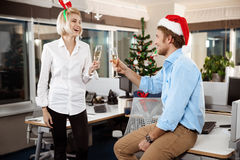 Colleagues celebrating christmas party in office drinking champagne smiling. Stock Photos