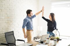 Colleagues celebrating a job well done Royalty Free Stock Image