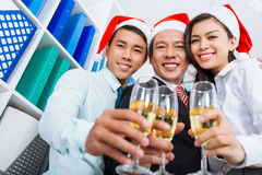 Colleagues with champagne flutes Stock Photo