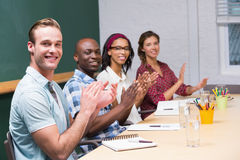 Colleagues clapping hands in meeting Stock Images