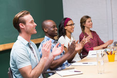 Colleagues clapping hands in meeting Royalty Free Stock Photography