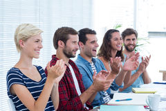 Colleagues clapping hands in meeting Royalty Free Stock Photos