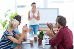 Colleagues clapping hands in a meeting Stock Photos