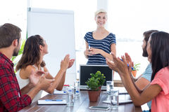 Colleagues clapping hands in a meeting Royalty Free Stock Image