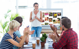 Colleagues clapping hands in a meeting Stock Image