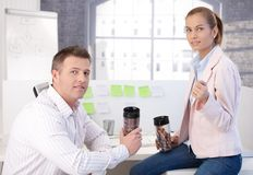 Colleagues during coffee break in office Royalty Free Stock Photos