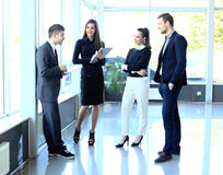 Colleagues communicating at meeting Royalty Free Stock Image