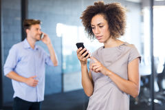 Colleagues communicating on mobile phone Stock Images