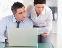 Colleagues comparing a blueprint Stock Photography