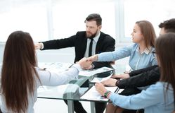 Colleagues confirming the job with a handshake. Teamwork royalty free stock image