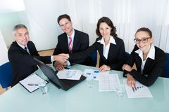 Colleagues congratulating one another Stock Photography