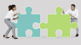 Colleagues connecting puzzle pieces royalty free stock photos