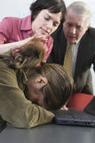 Colleagues consoling woman. Stock Photo