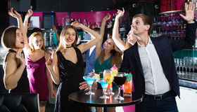 Colleagues dancing on corporate party with cocktails in hands Stock Image