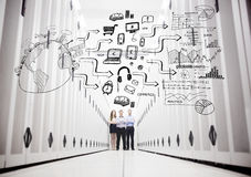 Colleagues in a data center standing in front of a drawing Royalty Free Stock Image