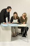 Colleagues at a Desk Royalty Free Stock Photo