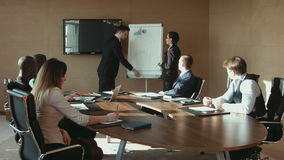 Colleagues discuss at the meeting Business stock footage