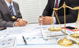 Colleagues are discussing issues. Related to lawsuits and counseling to fight lawsuits in court stock photo