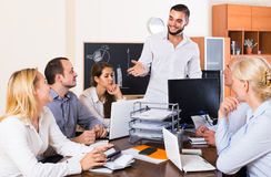 Colleagues discussing price development at office Royalty Free Stock Images