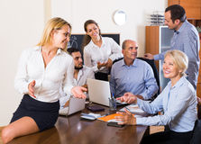 Colleagues discussing price development at office Stock Photos