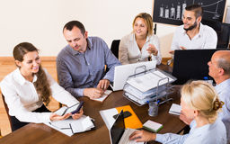 Colleagues discussing price development at office Royalty Free Stock Photo