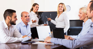 Colleagues discussing price development Stock Image