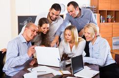 Colleagues discussing price development Royalty Free Stock Images