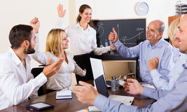 Colleagues discussing price development Stock Photography