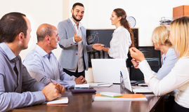 Colleagues discussing price development Royalty Free Stock Photo