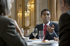 Colleagues In Discussion At Restaurant Table Royalty Free Stock Photography