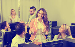 Colleagues drinking champagne at office Stock Image