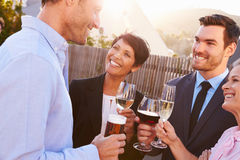 Colleagues drinking after work at a rooftop bar Royalty Free Stock Images