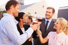 Colleagues drinking after work at a rooftop bar Royalty Free Stock Photos