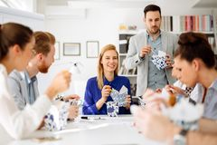 Colleagues eating in office. During lunch break royalty free stock photos