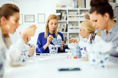 Colleagues eating in office. During lunch break royalty free stock image