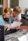 Colleagues examine broadcast list Stock Image