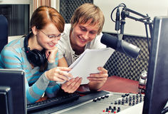 Colleagues examine broadcast list Royalty Free Stock Photography