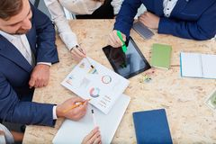 Colleagues examine schedules in the interview. Inside the office. stock photos
