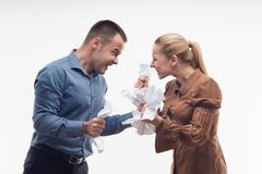 Colleagues fighting each other with paper in fists Stock Image