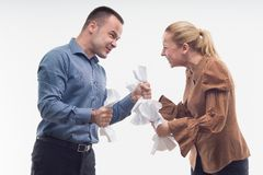 Colleagues fighting each other with paper in fists Stock Photos