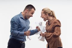 Colleagues fighting each other with paper in fists Royalty Free Stock Photos