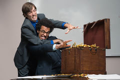 Colleagues fighting over money Royalty Free Stock Images