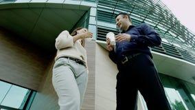 Colleagues flirt during a break stock video footage