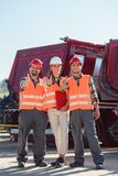 Colleagues in a freight forwarding company giving thumbs up. In front of trucks stock photos