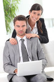 Colleagues in front of laptop Royalty Free Stock Photos